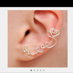 No piercing required, just a clip on. Absolutely adorable! Etsy.com  **Search: Ear Cuff**