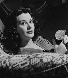 Hedy Lamarr with a crystal ball at home by Clarence Sinclair Bull, 1940s