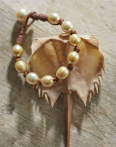 """Known for their calming effect, pearls can balance one's karma, strengthen relationships, and keep children safe. The """"All Around"""" bracelet in golden South Sea pearls by designer Wendy Mignot"""