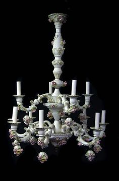 This is a fabulous Capodimonte Italian Porcelain Chandelier marked. Great piece with 4 arms around the top and 8 arms in the second lower tier. It is 24 inches across and a wonderful 32 1/2 inch drop.