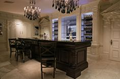 Clive Christian architectural bar in ivory and walnut. James Bond on the TV