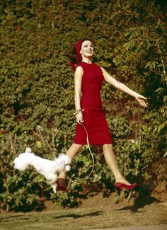 Actress Natalie Wood, flying, with a very happy poodle.
