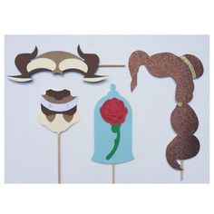 Don't forget the Photo Booth! Beauty and the Beast props for your Disney themed wedding.