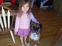 A girl and her puppy.