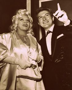 """Mae West and Liberace look over the lobby display after they and other celebrities arrived for the Hollywood premiere of """"Les Poipees de Paris,"""" a sexy puppet show, May Old Hollywood Glamour, Vintage Hollywood, Classic Hollywood, Star Wars, Mae West, Piano Player, Guys And Dolls, Hooray For Hollywood, Stars Then And Now"""