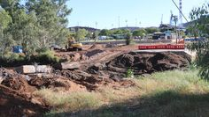 ISA ST BRIDGE: Rubble was bulldozed away from the Leichhardt riverbed after the Isa St bridge was demolished last week. Mr Beard, Peter Beard, Five Hundred, City Council, Man Swimming, Over The Years, Bridge, Old Things, Australia