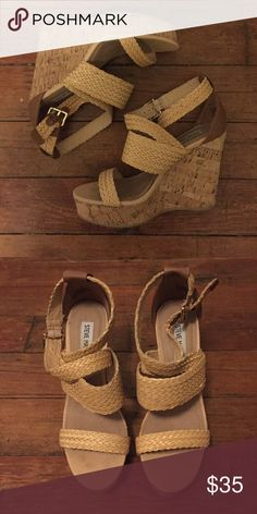 """Steve Madden Braided Wedges Weave your warm weather look together with these fabulous wedge sandals from Steve Madden. The Slippie is the perfect sandal to complement your carefree, casual style. Woven faux leather upper. Criss cross straps with adjustable buckle. 1¼"""" platform, 4½"""" cork wedge heel. Only worn once! Steve Madden Shoes Wedges"""