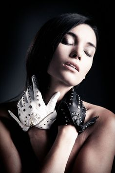 Majesty Black Bandita Drivers Gloves.    #fashion #accessories #leather #studdedkeyholegloves #majestyblack #keyhole #whiteleather #blackleather #studs #majestygloves  www.majestyblack.com  Model: Kristall Chenut   Photographer: Simen Made Platou