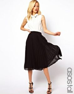 Loving the midi skirt trend. Perfect for tall women.