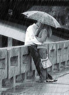 Kissing in the rain.