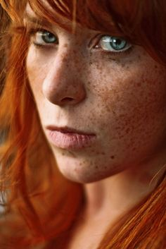 Omg beautiful freckles! love the orange hues of the hair & freckles & the stark contrast of the eyes