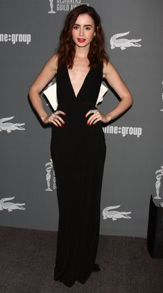 http://www.aceshowbiz.com/images/wennpic/lily-collins-15th-annual-costume-designers-guild-awards-01.jpg
