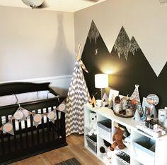 Gray, white and orange baby nursery. Woodland Native American teepee. Dark black crib.
