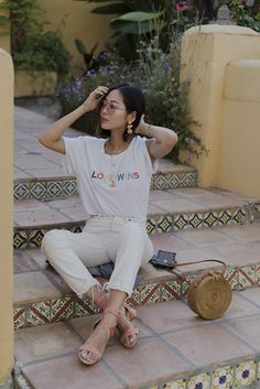 Aimee Song of the blog Song of Style shares an outfit wearing the Two Songs love wins tee and distressed white Levi's jeans.