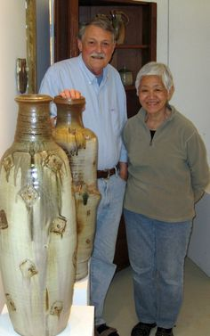 David and June at the shop, standing with some of Andrew's large vessels. www.otispottery.net
