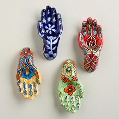 One of my favorite discoveries at WorldMarket.com: Painted Ceramic Hands, Set of 4$30