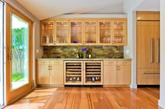 Example of glass front cabinets entire length of cabinet area!  Again, pot lights utilized as under cabinet lighting.