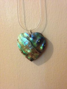 A personal favorite from my Etsy shop https://www.etsy.com/listing/534576347/shell-heart-necklace