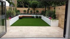 modern urban low mainteance garden design balham clapham dulwich fulham chelsea london travertine cream paving artificial grass cedar screen raised beds low maintenance architectural planting