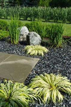 Black Landscaping Rocks Instead Of Mulch For Front Of