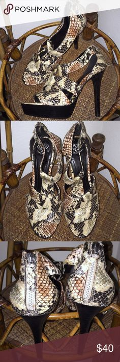 BCBGeneration Platforms BCBGeneration Snakeskin Platform Stillettos in size 6 come in LIKE NEW condition. Only worn once! Super sexy. Very trendy! In EXCELLENT condition.❤️ Shoes Platforms