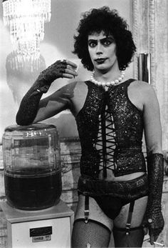 Tim Curry having a smoke break on the set of 'The Rocky Horror Picture Show', 1975.