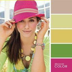 Chica usando un vestido de color verde y un sombrero de color rosa
