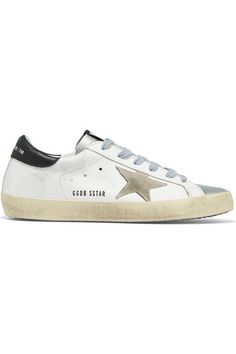 Golden Goose Deluxe Brand's sneakers have been made in Italy from white, silver and black leather and set upon spongy rubber soles – brushed and waxed by hand to create the look of old favorites. The beige suede star is a label signature. | NET-A-PORTER.COM