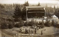 "The faded glory of Shively Park - Indians perform a ""war dance"" at Shively Park for Astoria's centennial celebration in 1911. The wooden amphitheater was modeled on the University of California's Greek Theater. The clear cut made for a good view from the park."
