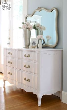 """Fresh and pretty French Provincial dresser and mirror makeover using Benjamin Moore Advance paint in """"Silky Smooth"""" and champagne gold for the mirror."""