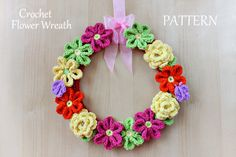 Crochet pattern Flower Wreath. What a great idea. Buy a $5 pattern & make wreaths as Christmas gifts in any color!