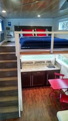This is a modern tiny house on wheels in Orlando, Florida that you can stay in on your next vacation to Florida. It has a covered side entrance with a deck staircase to help you get through the pre…