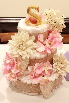 Chic diaper cake with burlap and lace ribbon. Pink and burlap flowers. Love is all you need and Hugs and Kisses sign. Made with Love for Baby Stella.