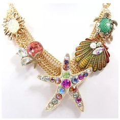 """ED21 Crystal Seashell Turtle Statement Necklace ‼️PRICE FIRM‼️    Aquatic Necklace  Retail $99  Really fun and stylish necklace. Sure to dress up any outfit. Gorgeous bright color crystals.  Necklace is approximately 21"""" long, including the 3"""" of extender chain. Free matching turtle earrings.  Earrings hang down approximately .75"""". Please check my closet for many more items including designer clothing, scarves, shoes, handbags & much more! Boutique Jewelry Necklaces"""
