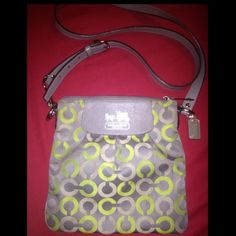 Authentic Coach purse Medium Patchwork Coach purse. Grey and lime green used about a month with adjustable shoulder strap. Zipper closure and inner pocket comes with original authentication card. Has a few stains on inner lining may come out if cleaned properly Coach Bags