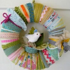 love this spring crazy wreath made with bits of this & that, including vintage & found fabrics, doll clothes, ribbon & yarn & a great bird!