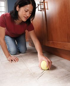 """Rub scuffs marks with a dry tennis ball  Clean off shoe scuff marks from vinyl flooring with a clean, dry tennis ball. A light rub and heel marks are """"erased""""."""