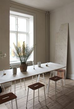 utilitarian dining table with stools, wooden floor