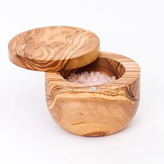 With a smart swiveling lid, this container is worth its salt. Olive wood salt keeper, $50; williams-sonoma.com;