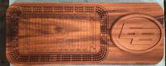 Edmonton Eskimo's cribbage board cut on tigerwood and sappele with removable logo for card and peg storage. Custom Metal, Custom Art, Cribbage Board, Bamboo Cutting Board, Art Pieces, Logo, Storage, Purse Storage, Logos