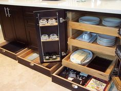I think I'm getting hooked on custom kitchen cupboards - look at the drawers in the normal toe kick area. I would keep pot lids, placemats, BBQ utensils etc in them.