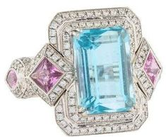 18K Blue Topaz, Pink Sapphire & Diamond Cocktail Ring. Topaz jewelry. I'm an affiliate marketer. When you click on a link or buy from the retailer, I earn a commission.