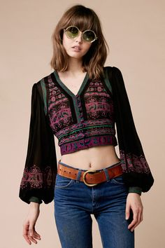 I still own a similar item that I bought in the 90s. It has a hood though and faux fur around the fringe. I called it my Janis Joplin top because I always pictured her wearing something like that. I never wore it because my body isn't really made for crop tops, though I always held out hope that someday maybe I could get there