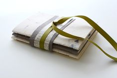 Video tutorial on how to make this cute set of notebooks with pockets. #handmadebooks #handmadepaper