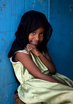 Veiled young girl smiling, Pemba, Tanzania
