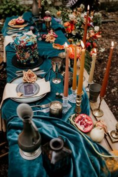 burnt orange candles with teal velvet runner      #wedding #weddingideas #weddingcolors