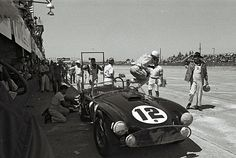 Phil Hill in for a pit stop at Sebring 1963    The great Phil Hill leaps from this Shelby Cobra during a pit stop at the 1963 Sebring 12 hour race. Hill's co-drivers were Ken Miles and Fireball Roberts. The car finished in 11th place but first in class. Note another legend waiting to talk to Hill. None other than Carroll Shelby wearing his trademark bib overalls and Stetson hat. Just think of it, Hill, Miles, Roberts and Shelby all in one spot. This was the era of legendary racing, legendary car