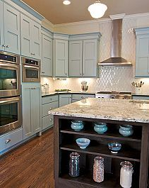 beautiful kitchen! love the color of the cabinet!