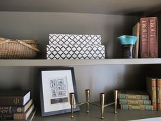 Love these boxes from Homegoods...great for stacking in bookcases!- I need some of these!