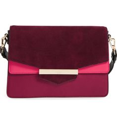 Bold color blocking and mixed textures add trend-savvy sophistication to this chic, cosmopolitan leather-and-suede bag by Kate Spade.